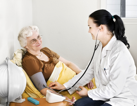 Senior lady having his blood pressure checked by a doctor