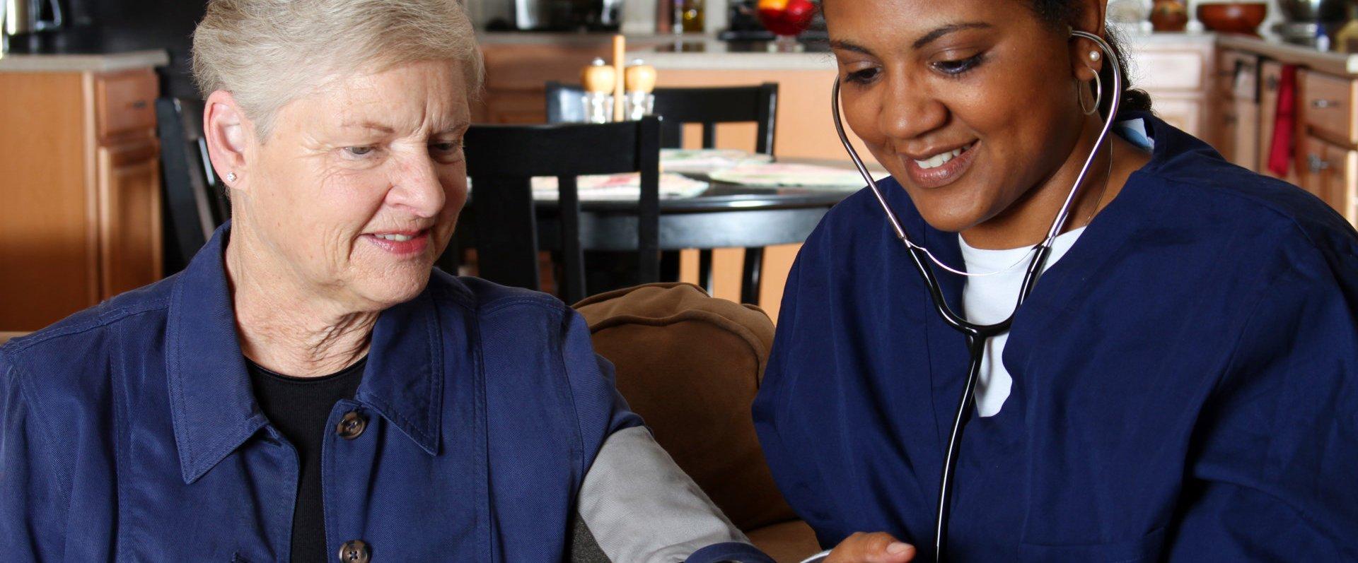 nurse checking the health of an elderly woman